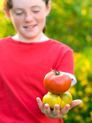 girl-with-2-heirloom-tomatoes.jpg